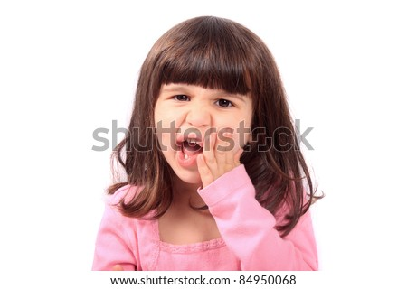 Cute young four year old child holding her cheek with a toothache - stock photo
