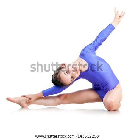 cute young girl doing gymnastics isolated over white - stock photo