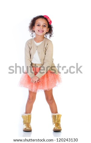 Cute young girl in a pink skirt