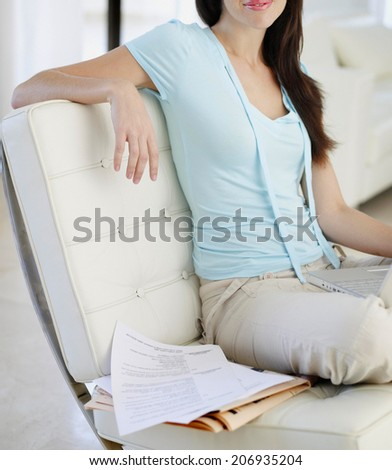 cute young girl relaxing on couch at home