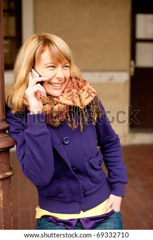 Cute young girl speakong on cellphone - stock photo