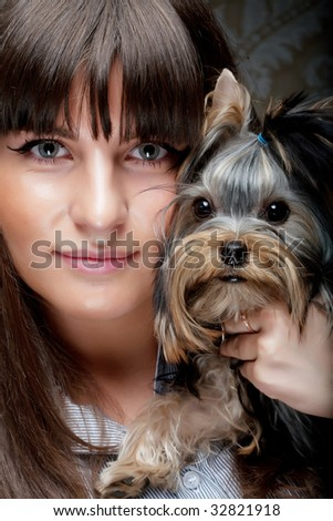 Cute young girl with her Yorkie puppy