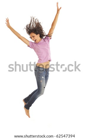 Cute young girl with jeans and pink top jumping energetically