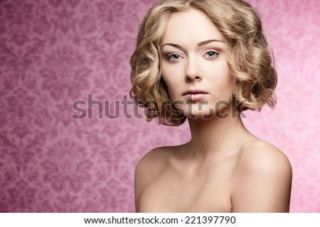 cute young girl with natural look posing in beauty portrait with short curly hair-cut and perfect skin  - stock photo