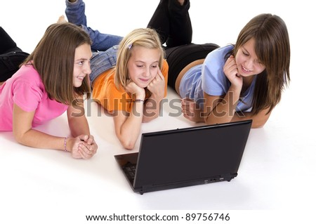 cute young girls with computer on white