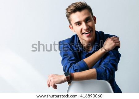 Cute young guy is resting with joy - stock photo