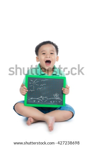 Cute young happy preschooler asian boy holding up black board for copy isolated on white - stock photo