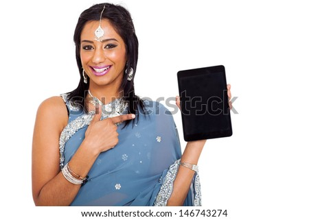 cute young indian woman in sari pointing tablet computer on white background - stock photo