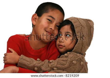 Cute young kids (brother and sister) hugging - stock photo