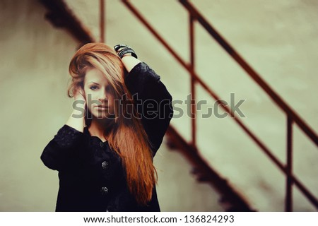 Cute young lovely red hair girl