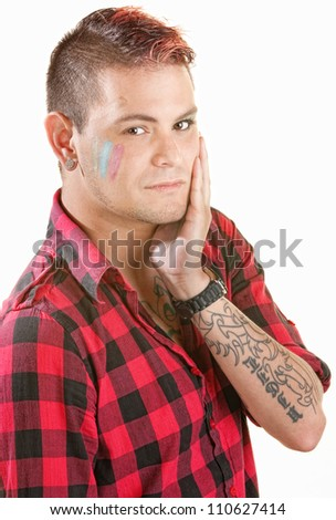 Cute young man with spiky hair paint on face - stock photo