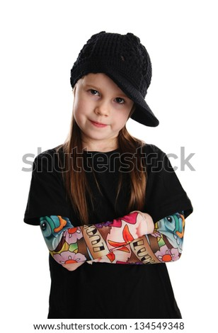 Cute young preschool age girl isolated on a white background, wearing tattoo punk clothes and rock star