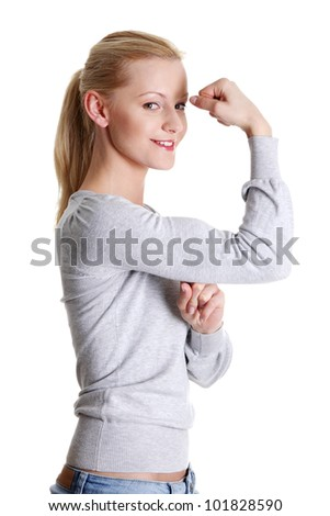 Cute young smiling woman showing her biceps, isolated on white background - stock photo