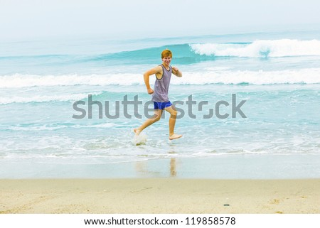 cute young teenage boy has fun at the beach