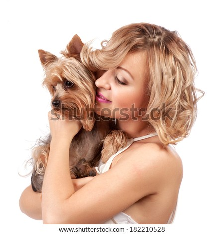 Cute young woman cuddling her dog while sitting isolated on white - portrait - stock photo