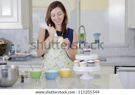 Woman Decorating Cupcakes cupcake decorating stock photos, royalty-free images & vectors