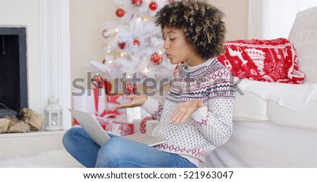 Cute young woman having a video chat at Christmas