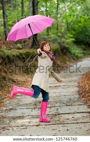Cute young woman having fun after raining - stock photo