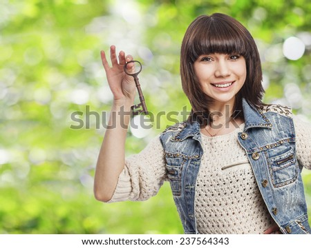 cute young woman holding an old key