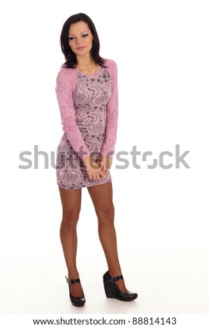 cute young woman in dress posing on white