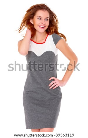 Cute young woman in gray dress on white background