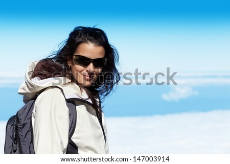 Cute Young Woman in High Mountain Range wit a Sea of Clouds - stock photo