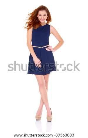 Cute young woman in navy blue dress on white background - stock photo