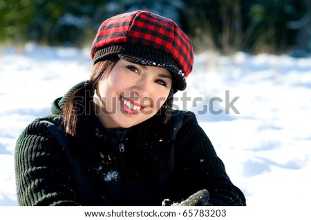 Cute young woman in the snow
