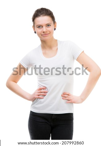 cute young woman in white t-shirt and black trousers posing - stock photo