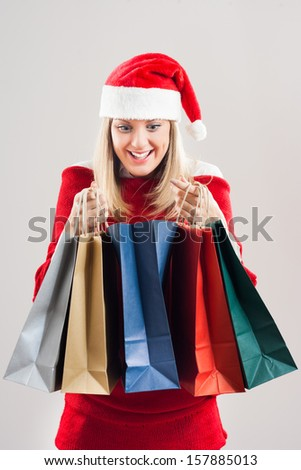 Cute young woman is excited about Christmas shopping,Christmas shopping