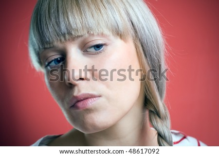 Cute young woman looking away - stock photo