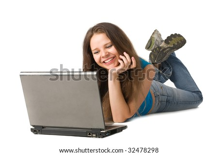 cute young woman lying down and using a laptop, isolated on white - stock photo