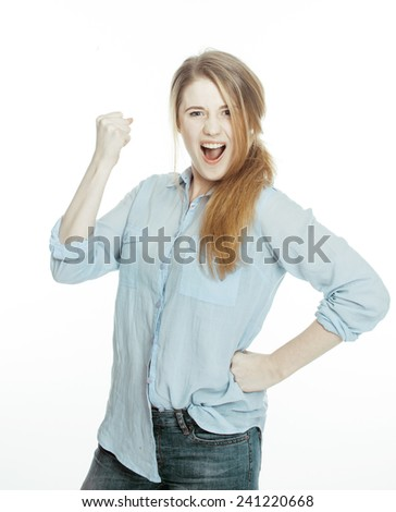cute young woman making cheerful faces on white background, messed hair isolated - stock photo