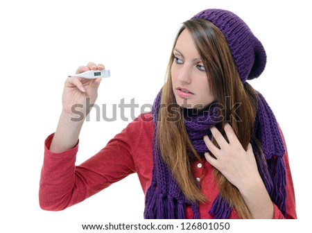 Cute young woman monitor her temperature with thermometer - stock photo