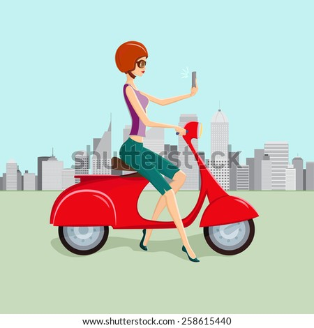 Cute young woman on red scooter making selfie against city skyscrapers on background.