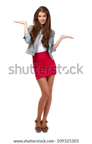 cute young woman posing in studio