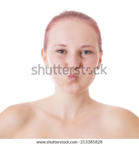 A woman with puffed cheeks covers her ears with her fingers ...