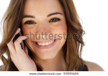 Cute young woman talking on a cell phone