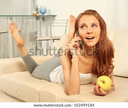 cute young woman talking on a phone - stock photo