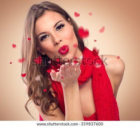 cute young woman to blow kisses - stock photo