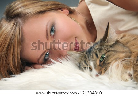 cute young woman with cat - stock photo