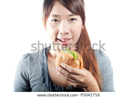 Cute young woman with fish burger in   her hand on  white background