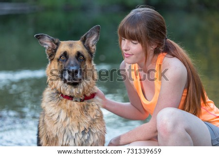 stock-photo-cute-young-woman-with-her-la