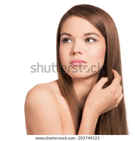 Cute young woman with long healthy brown hair. Natural look.