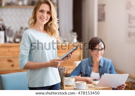 Cute young women working