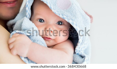 Cutest baby child after bath with towel on head - stock photo