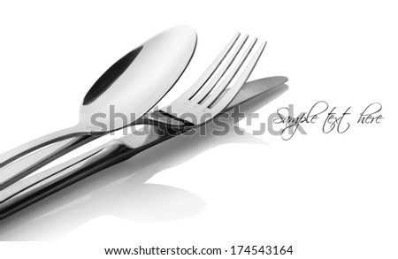 Cutlery - a spoon, fork and knife on a white background with space for text - stock photo
