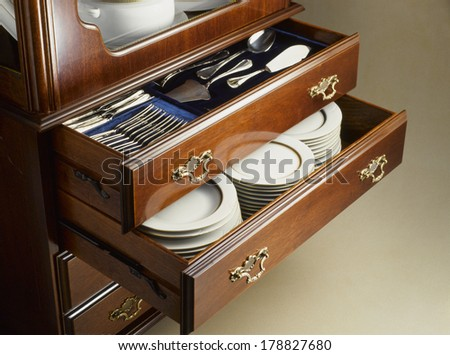 cutlery and crockery cabinet - stock photo