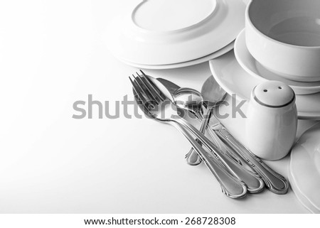 Cutlery and crockery on the table - stock photo