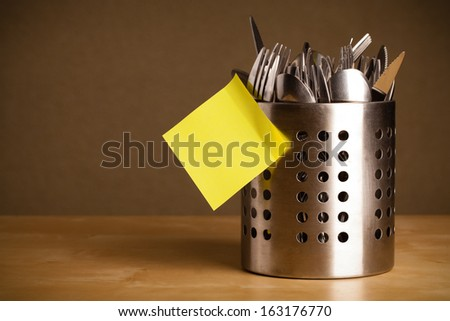 Cutlery case with empty sticky note - stock photo